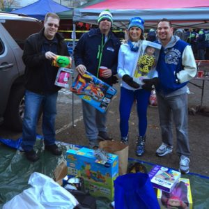 Four people collecting donated gifts